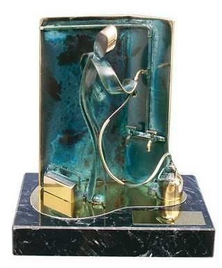 Trofeo fontanero arreglando